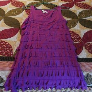 Purple sleeveless dress.